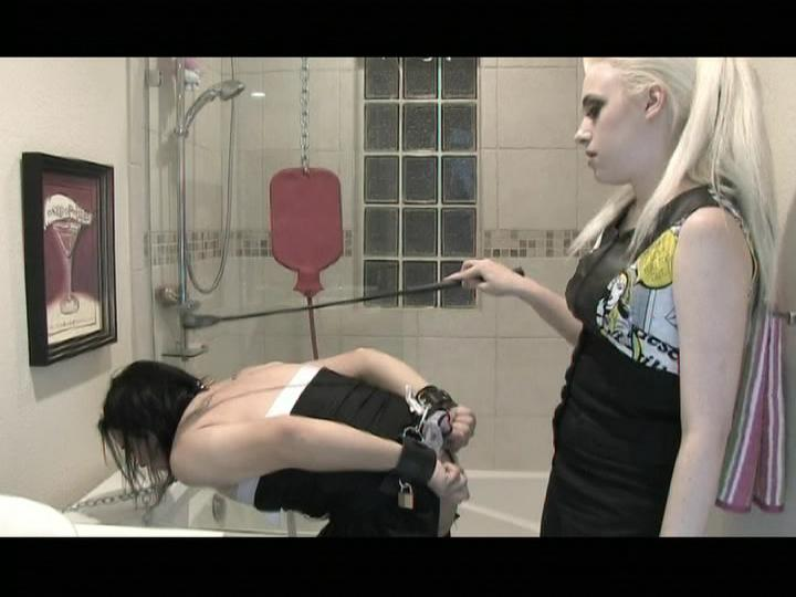Sissy Maid Slave / This fetish clip from Sissy Maid Slave by Transfetish Productions features a sissy tranny maid getting his hot little slut ass all clean with a forced enema, bent over and chained to the toilet.