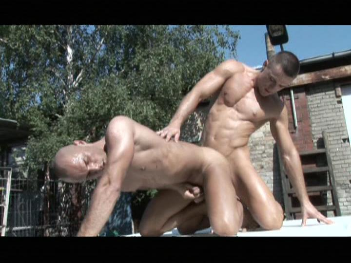 This backyard ass-fucking scene from Junkyard Cumholes by Dark Alley Media features a couple of muscular hotties going at it in full sun, plunging that big cock into that tight wet little ass hard.