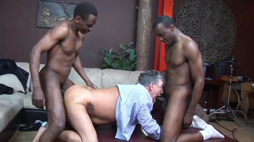 This clip from Blacks On Daddies 4 by Older4Me features a horny mature man on his knees sandwiched between two black men, getting fucked by one and sucking the other one's hard cock.