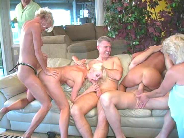 This clip from All Star Porn Star House Party by NEW PORN ORDER-NPO features a all-holds-barred orgy scene with a crowd of blonde sluts sucking dick and fucking each other with strap-ons.