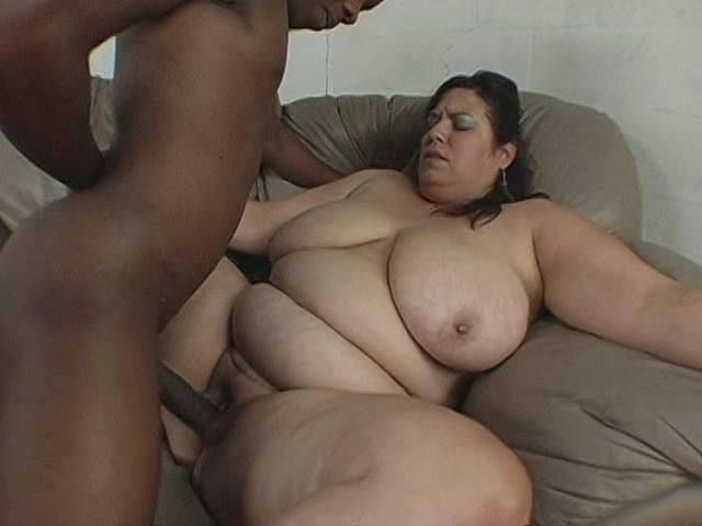 BBWs Gone Black 9 / This clip from BBWs Gone Black 9 by Sensational Video features the very horny Rikki Waters getting her wet pussy plowed from behind, showing off her fat belly and big natural breasts bouncing.
