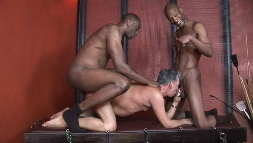 This clip from Blacks On Daddies 6 by Older4Me features a horny older white man on his knees getting his ass rammed hard and deep with a big black dick while he sucks on another one, hungry for more.