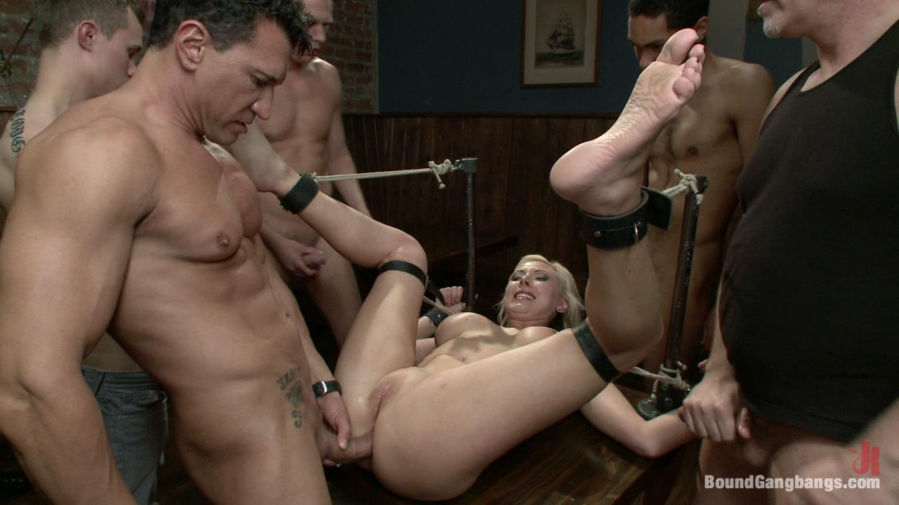 Bound Gangbangs: Skylar Price / Skylar Price plays a sexy lawyer who fantasizes about being blackmailed by her client. In her fantasy she is taken to a bar full of men and stripped naked while her client, Mark Davis, takes photos.