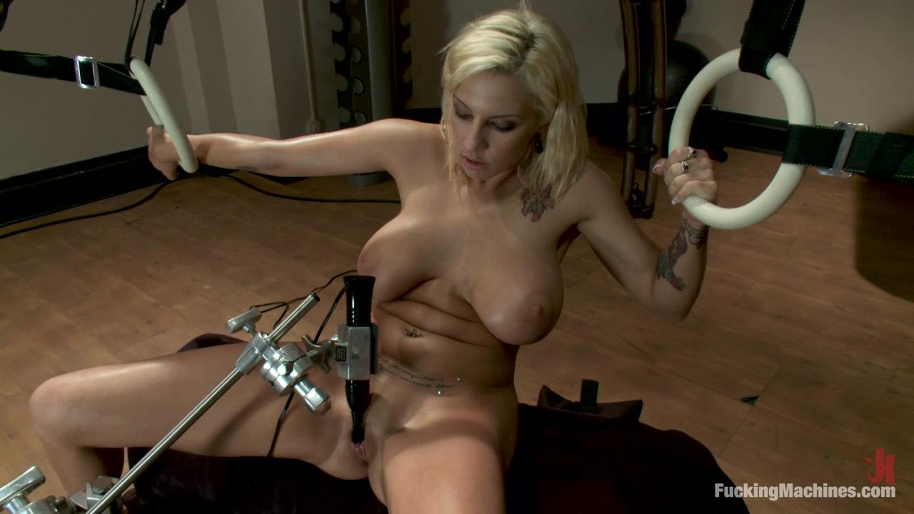 Fucking Machines: Lylith Lavey / Lylith is flexing her arms and abs as The Dragon works out her perfect pussy. She leans in doggie over the exercise ball and uses the ball's movement to push a pink dildo deep inside her and to rock with the pounding machine.