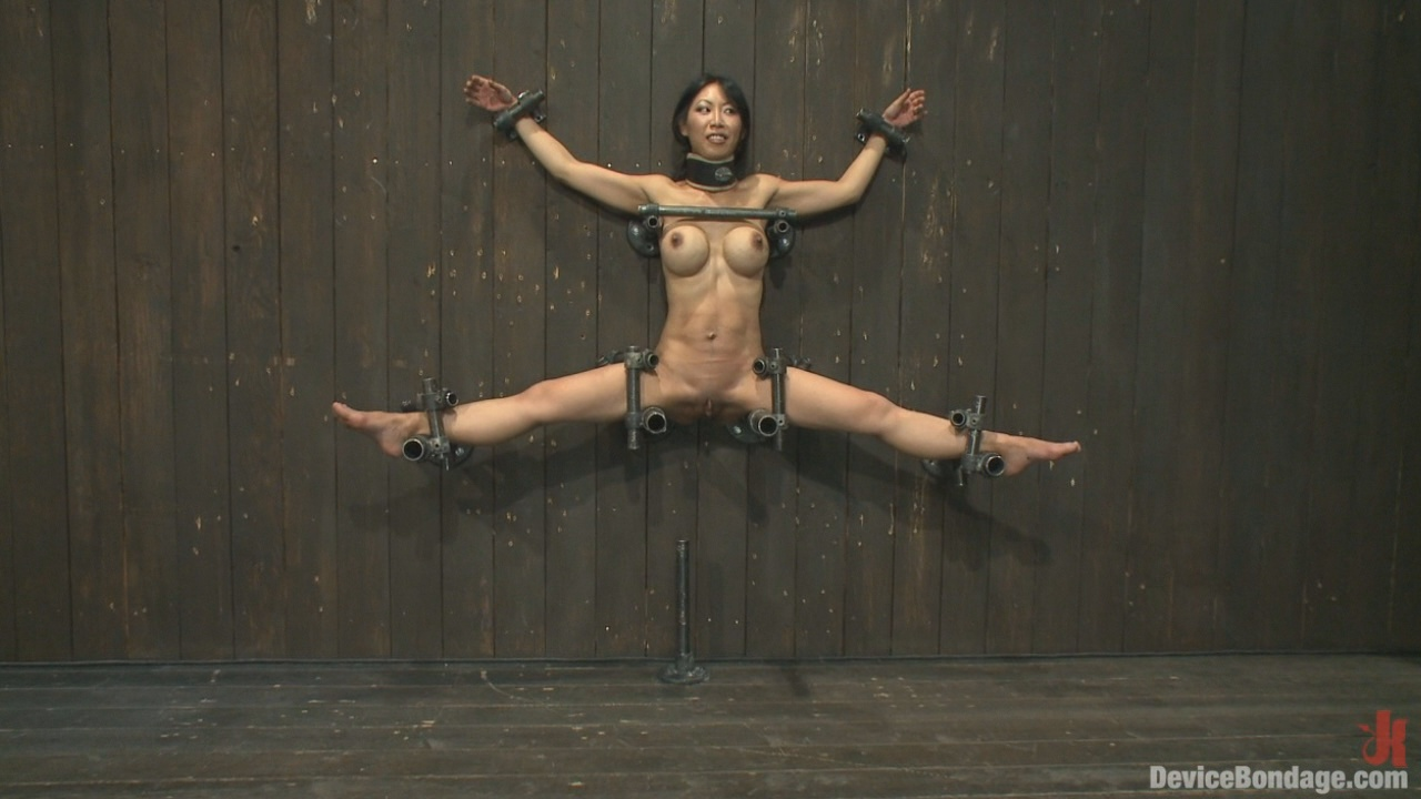 Device Bondage: Tiny Tia Takes Tenacious Torment / Tia's tight little body is pinned up against the wall into the splits into a spread so we can get to all her sensitive body parts.