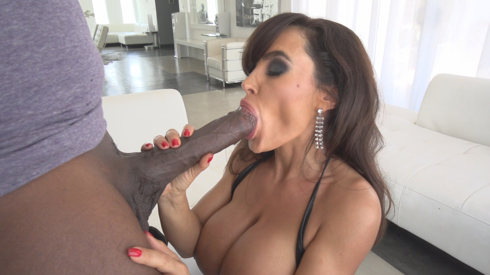 Lisa Ann's Black Out /  Interracial MILF porn! Featuring MANDINGO In Two Scenes and Lisa Ann In EVERY Scene in the adult DVD Lisa Ann's Black Out! Lisa Ann takes on the ninth wonder of the world…Mandingo!