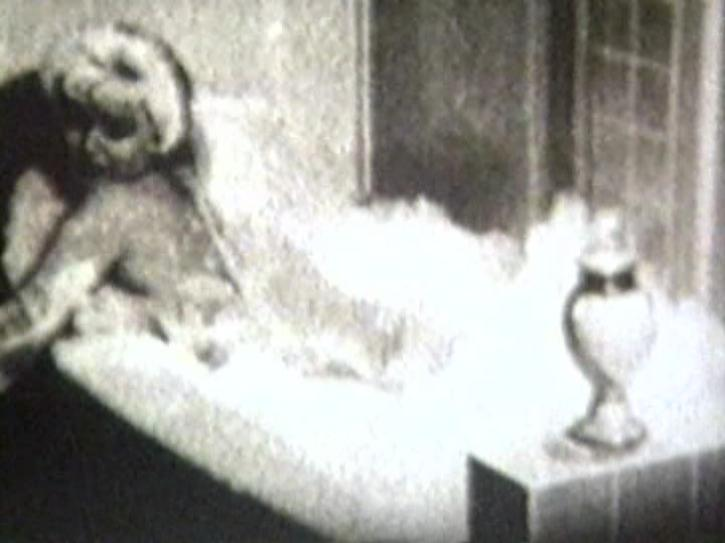 Celebrity Sex Tapes / This notorious clip from Celebrity Sex Tapes by Dreamland and K-Beech features Marilyn Monroe posing seductively and playfully in a bubble bath, coyly showing her full, beautiful breasts.