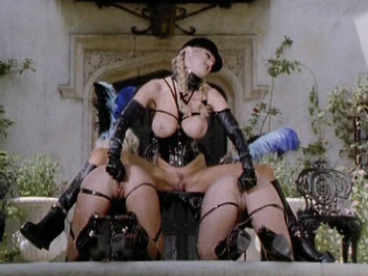 Hell on Heels / This clip from Hell on Heels by Wicked Pictures features Jenna Jameson sitting astride two hot blonde pony girls, fucking them with silver dildos, with her own pretty pussy out for us to see.