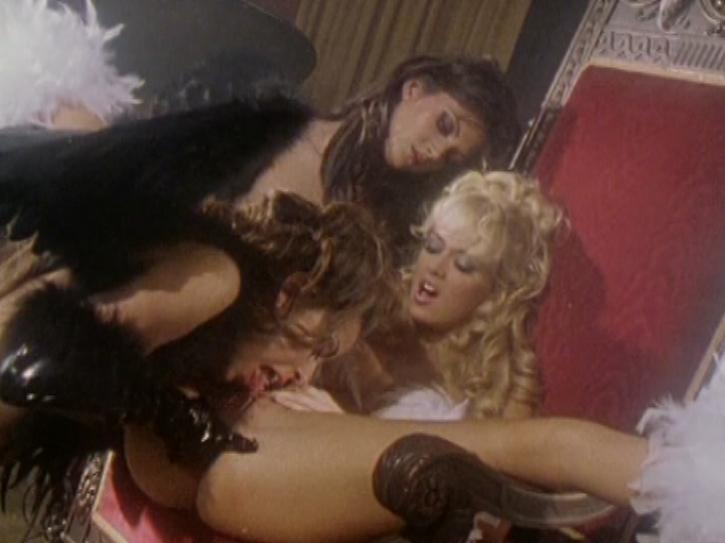 Hell on Heels / This clip from Hell on Heels by Wicked Pictures features Jenna Jameson spread open on her throne, with her two fallen angel sluts licking her sweet little cunt and fingering her while she moans.