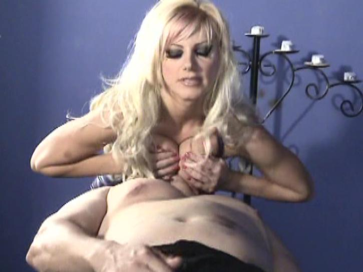 Brittany Andrew's: Bitches Beating Boys / This clip from Brittany Andrew's: Bitches Beating Boys by Brittany Andrews features a lucky little slave getting smothered by his mistresses big titties and forced to jerk off.
