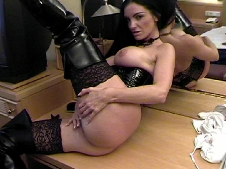 Watersports Und Dildo-Fun / This clip from Watersports Und Dildo-Fun by Carmen Rivera Entertainment features a hot German goth chick with long black hair in black PVC modeling and stroking her beautiful little pussy.